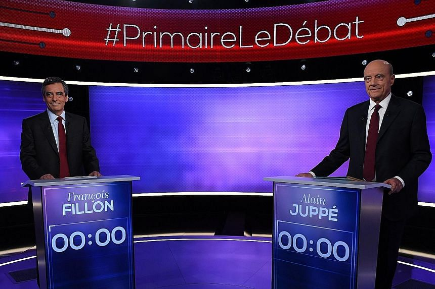 Mr Fillon and Mr Juppe - the two finalists in France's conservative presidential primary - before their televised debate on Thursday. TV viewers gave victory in the debate to Mr Fillon.