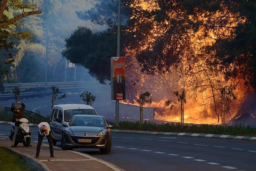 A fire on Thursday in a suburb of Haifa. Fires also raged in two areas on the outskirts of Jerusalem as well as near the Jewish settlement of Talmon in the occupied West Bank.