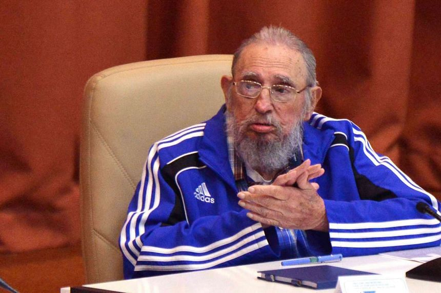 This file handout picture released by Cuban Agency ACN taken on April 19, 2016, shows former Cuban President Fidel Castro applauding during the closing ceremony of VII Congress of Cuban Communist Party (PCC) at Convention Palace in Havana.