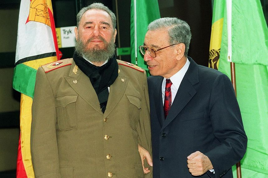 Cuban leader Fidel Castro being greeted by United Nations Secretary General Boutros Boutros Ghali on his arrival at Bella center conference hall in Copenhagen, on March 11, 1995.