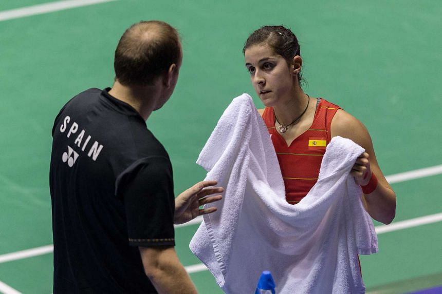 Carolina Marin of Spain speaks with her coach during a match against Tai Tzu-ying of Taiwan on Nov 26, 2016.
