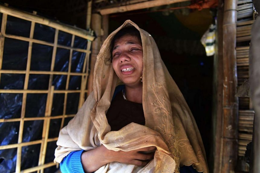 Myanmar Rohingya migrant Nur Begum reacts after the death of her six-month-old son Alam in a refugee camp in Teknaf on Nov 26, 2016.