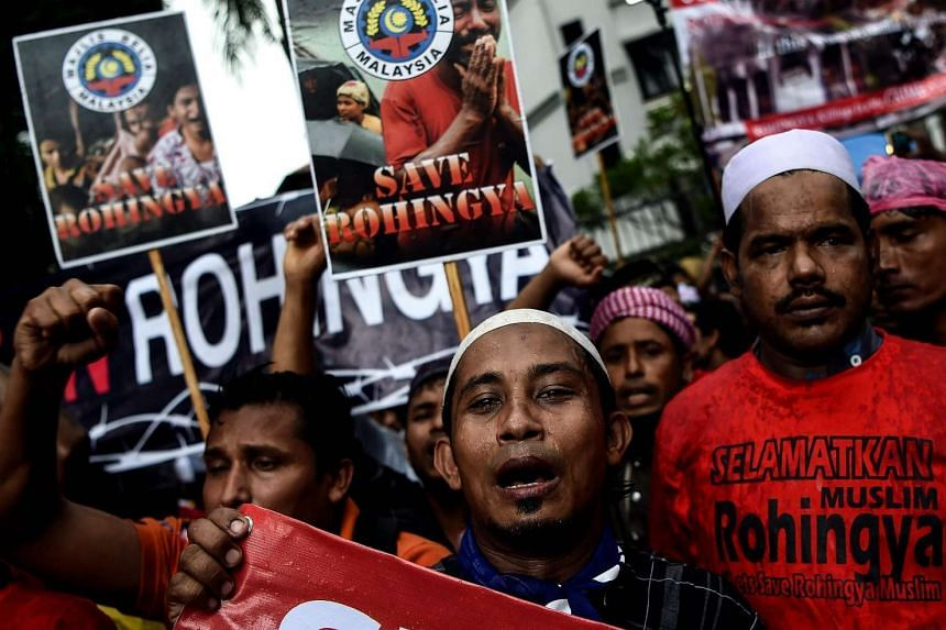 Ethnic Rohingya Muslim refugees shouting slogans during a protest against the persecution of Rohingya Muslims in Myanmar, outside the Myanmar Embassy in Kuala Lumpur, on Nov 25, 2016.
