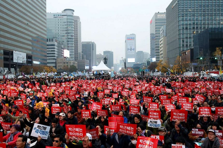 People chant slogans during a protest calling South Korean President Park Geun Hye to step down in Seoul, South Korea, on Nov 19, 2016.