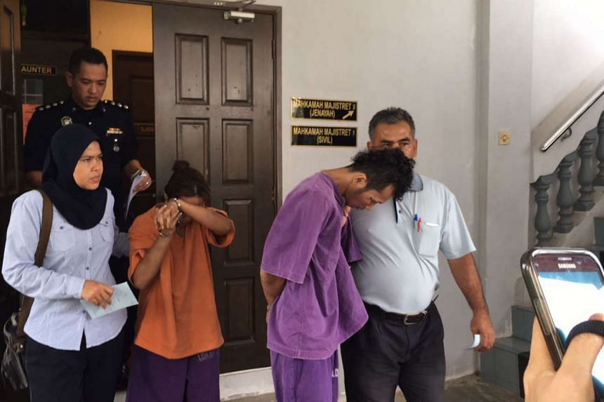 The suspects being led away by police. They are also being investigated for allegedly abusing the woman's four-year-old daughter.