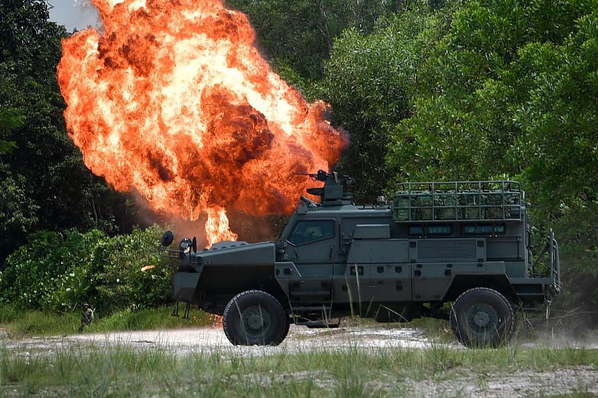 A Belrex Protected Combat Support Vehicle making its way past a simulated improvised explosive device blast in the Safti Live Firing Area during a demonstration yesterday.