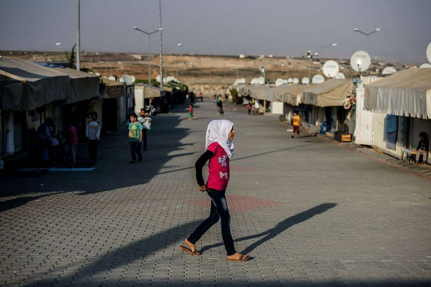 A Syrian child walking at a refugee camp in the Kilis district of Gaziantep, south-eastern Turkey, on Oct 23, 2016.