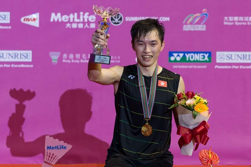 Angus Ng stands on the podium during the award ceremony for the men's single final at the Yonex-Sunrise Hong Kong Open badminton tournament in Hong Kong on Nov 27, 2016.