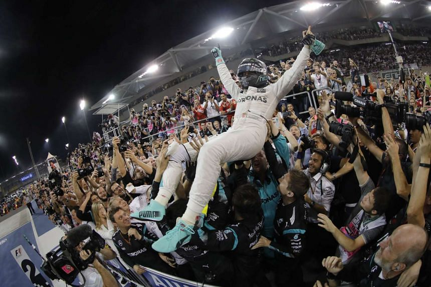 Nico Rosberg celebrates with his team after winning the Formula One World Championship 2016 at Yas Marina Circuit in Abu Dhabi, United Arab Emirates on Nov 27, 2016.