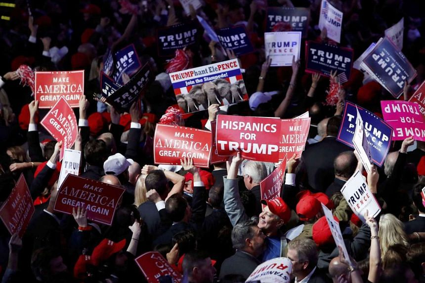 Trump supporters celebrate as election results come in ahead of the rally for Republican US presidential nominee Donald Trump in New York City on Nov 8.