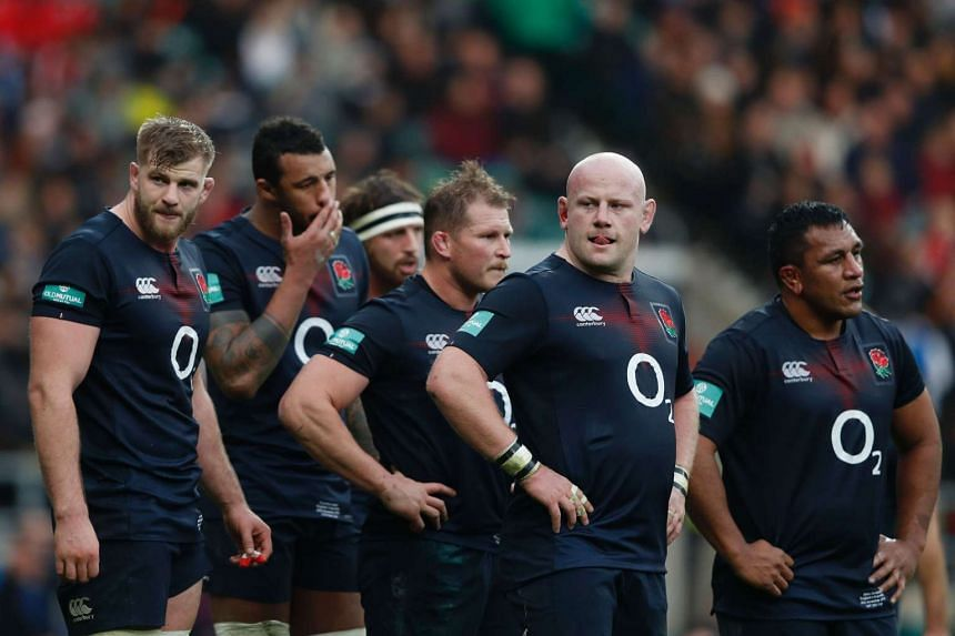 England's lock George Kruis, England's lock Courtney Lawes, England's hooker Dylan Hartley, England's prop Dan Cole and England's prop Mako Vunipola wait to scrum.