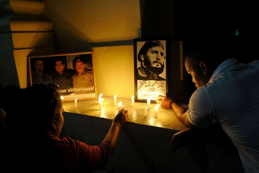 Students light candles in honour of Cuban historic revolutionary leader Fidel Castro a day after his death, at the Havana University in Havana on Nov 26, 2016.
