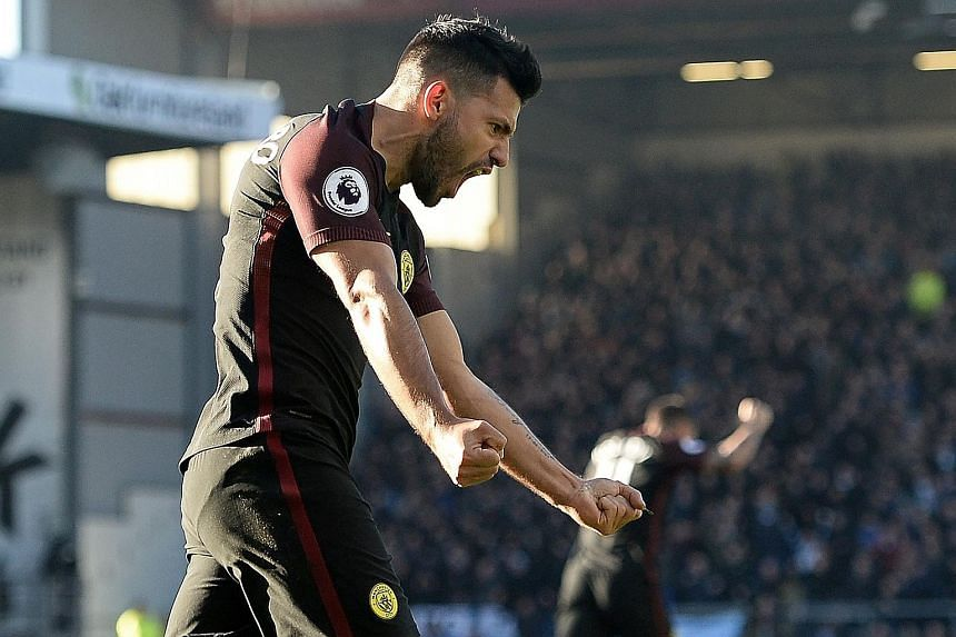 Manchester City's Sergio Aguero celebrating after netting the equaliser against Burnley. He went on to score a second to secure a 2-1 English Premier League win for City.