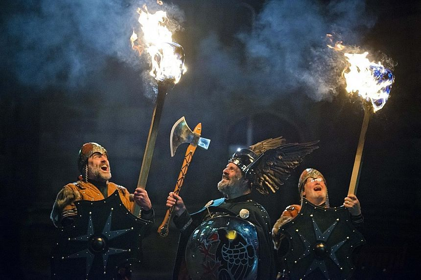 Pakistan's Kalasha people (above) celebrate the winter solstice in the festival Chaumos and a torch-lit procession (left) welcomes the new year at Edinburgh's Hogmanay.