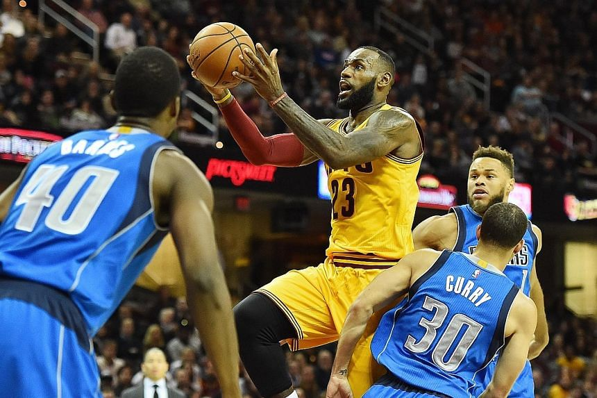 Cleveland Cavaliers forward LeBron James driving to the basket during their 128-90 victory over the Dallas Mavericks in the National Basketball Association on Friday. He finished the game with 19 points and 11 assists.