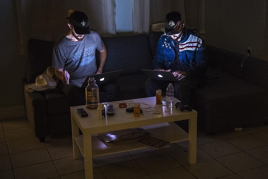 LibertyWritersNews founder Paris Wade (left) and Ben Goldman at work in their California apartment. Their venture illustrates how websites can use Facebook to tap into a surging ideology, quickly go from nothing to influencing millions of people and