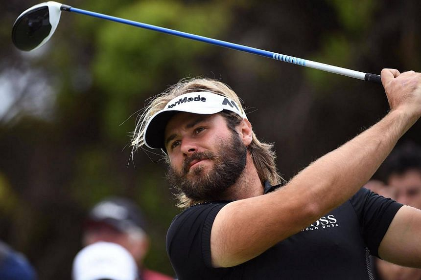 Victor Dubuisson of France tees off during the third day of the World Cup of Golf on Nov 26, 2016.