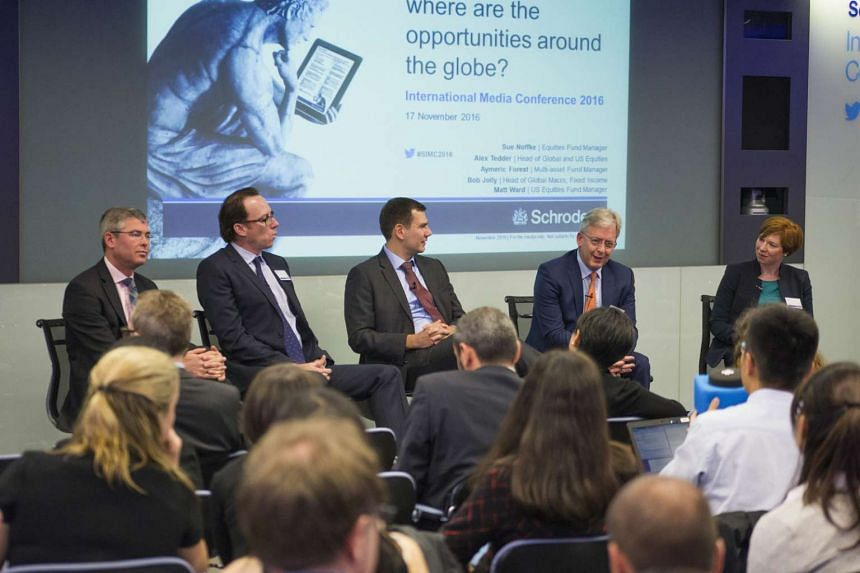 Schroders held its annual London conference last week. From left are Mr Simon Webber, global equities fund manager; Mr Matt Ward, US equities fund manager; Mr Aymeric Forest, head of multi-asset investments, Europe; Mr Bob Jolly, global macro head; a