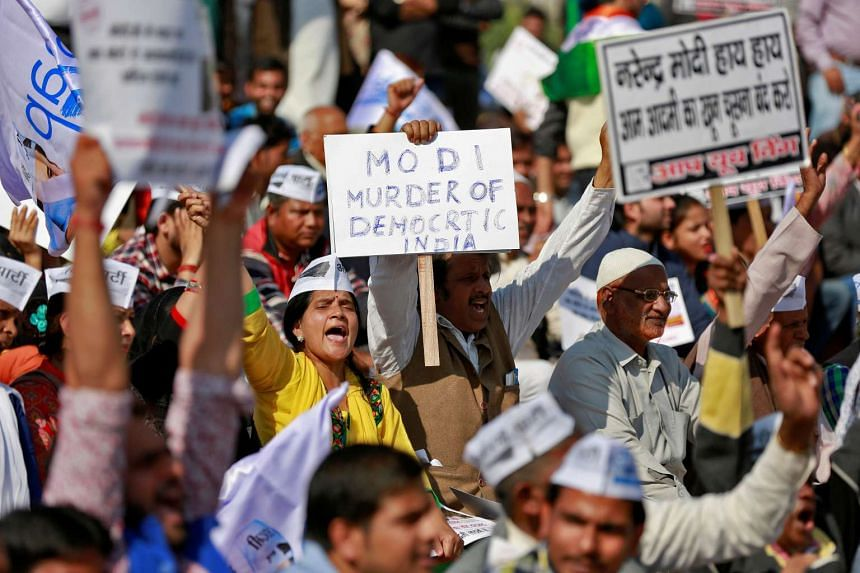People gather in central Delhi for a protest on Nov 28, 2016, against the government's decision to withdraw 500 and 1000 Indian rupee banknotes from circulation.