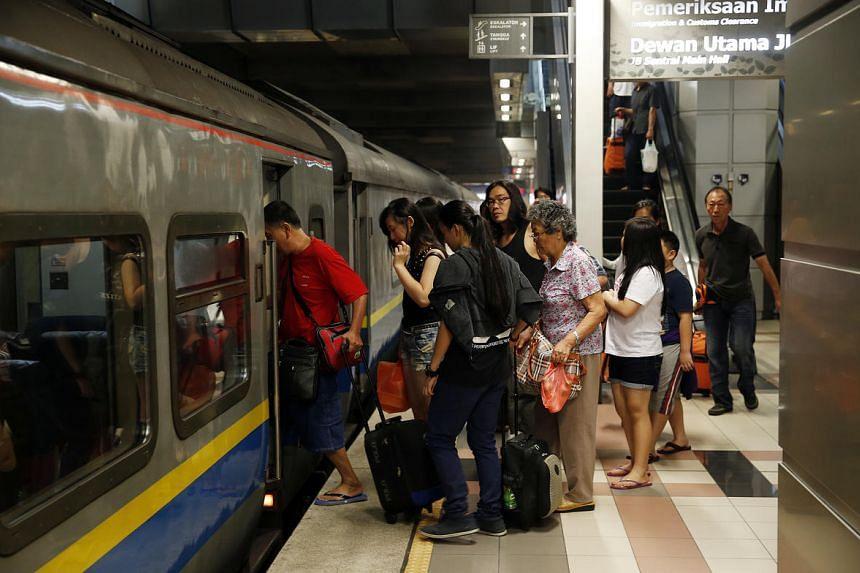 Commuters boarding the 8.30am Shuttle Tebrau train at JB Sentral.
