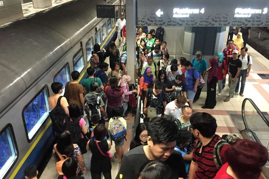 Commuters at the train station for the shuttle train service between Woodlands Checkpoint and JB Sentral, operated by Malaysian rail operator Keretapi Tanah Melayu (KTM).