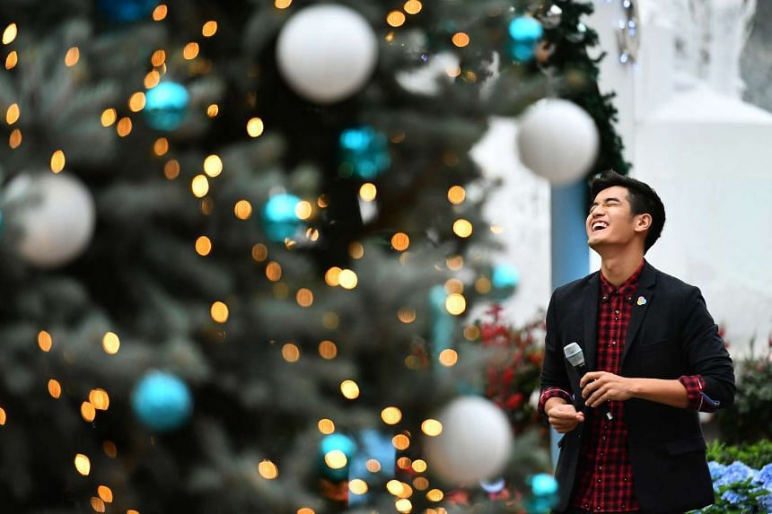 "Nathan Hartono singing a yuletide classic, ""The Christmas Song"", beside the 11-metre-tall Christmas Tower situated amidst the ""Merry Medley"" floral display in the Flower Dome at Gardens by the Bay on Nov 27 2016."