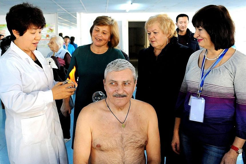 A Russian visitor receiving cupping therapy at an eldercare centre in Heihe. Last year, about 650,000 seniors travelled to Heilongjiang for leisure, spa visits and recuperative therapies.