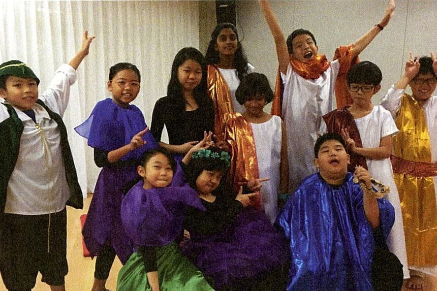 Aiden Peh (back row, hands raised) and his brother Issac Peh (far left) with cast members of Midsummer Chaotic Dreams. Aiden played the Duke of Athens and Issac played Puck.