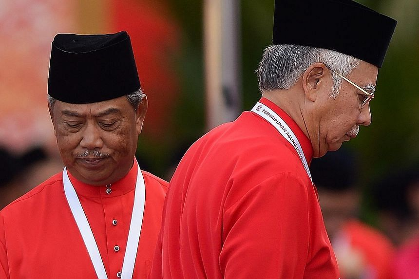 Former deputy prime minister Muhyiddin Yassin (left) and Mr Najib at last year's congress. This year, Mr Najib's supporters expect him to rally the party for the next general election, which he should win handily if the opposition ranks - including M