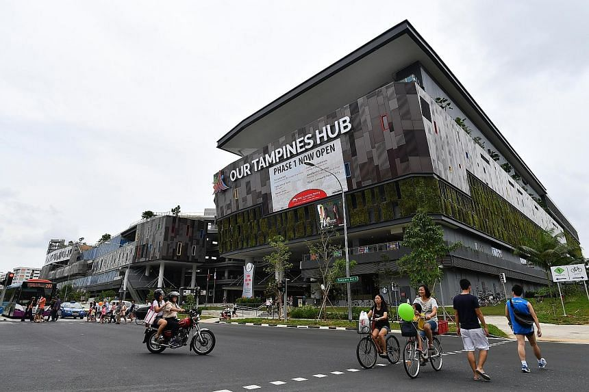 Above: The 800-seat hawker centre at Our Tampines Hub includes stalls operating 24/7. Left: The hub, located at the site of the former Tampines Stadium and Sports Hall, is expected to benefit some 200,000 residents in Tampines. Scheduled to be fully