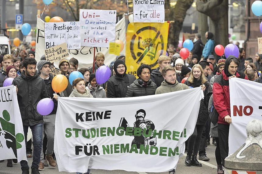 """Students with a banner declaring """"No study fees! For Nobody!"""" joining a march in the German city of Freiburg on Saturday. Several hundreds of them were protesting against the planned re-introduction of tuition fees for international students in Baden"""