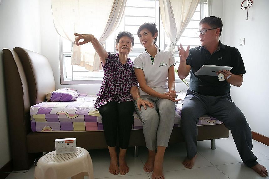 Madam Ng with Mrs Teo and ConnectedLife CEO David Ng. The 78-year-old says she no longer worries about being left alone and helpless if she falls or faints. The new sensor system in her home will send a mobile phone alert to her sons if trouble is de