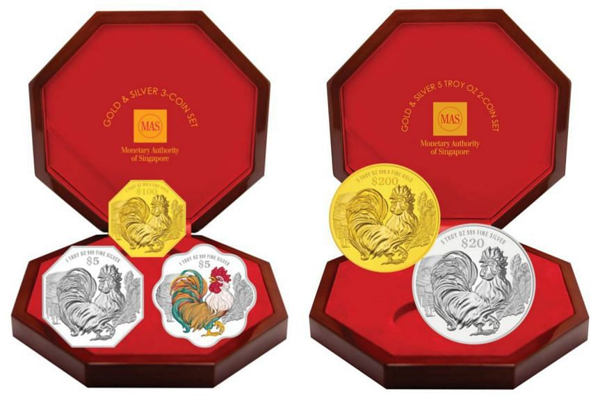 The gold and silver three-coin (left) and two-coin sets.