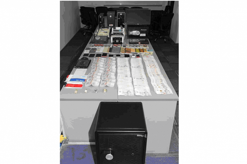 An array of computers, mobile phones, fax machines and cash amounting to about $1.3 million were seized as case exhibits during the operation, along with other documents such as betting records.