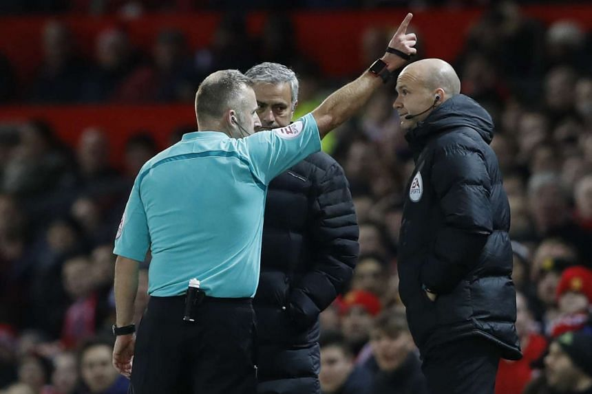 Manchester United manager Jose Mourinho is sent to the stands by referree Jonathan Moss.