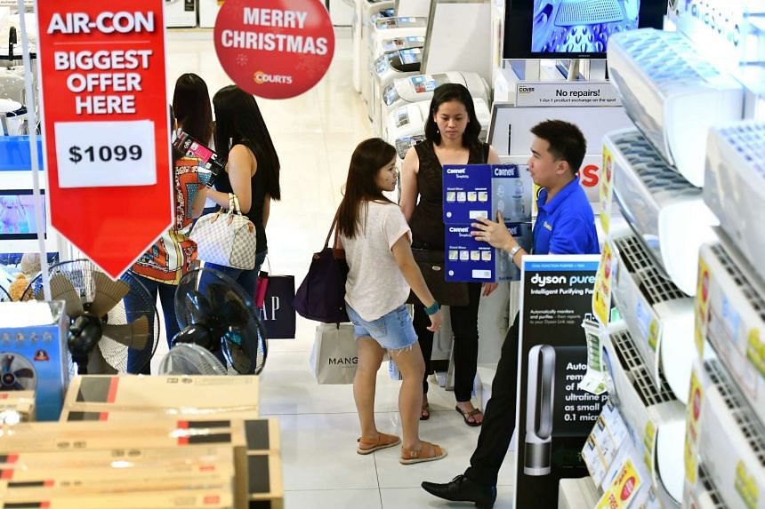 Shoppers in Courts at Courts Orchard during the Black Friday sale in Singapore on Nov 25 2016.