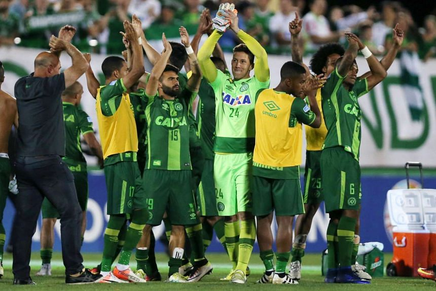 Players of Chapecoense celebrate after their match against San Lorenzo at the Arena Conda stadium in Chapeco, Brazil, Nov 23, 2016. A plane carrying members of the football team crashed late Monday (Nov 28).