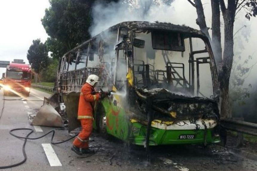 The driver, the tour guide and 30 passengers managed to escape unharmed from the burning bus.