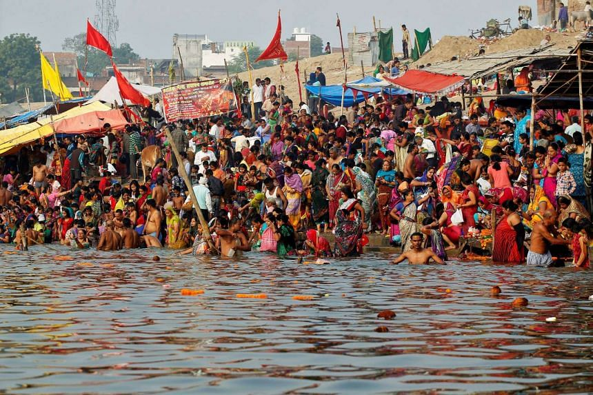 Hindu devotees gather to take a holy dip in the river Ganga on the occasion of the annual Hindu festival of 'Karthik Purnima' or full moon night, in Allahabad on Nov 14, 2016.