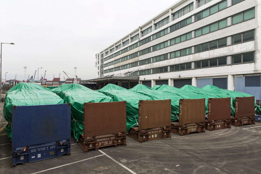 Armoured personnel carriers covered with green tarps are parked in a Hong Kong Customs and Excise facility in Tuen Mun, Hong Kong, China, on Nov 25, 2016.