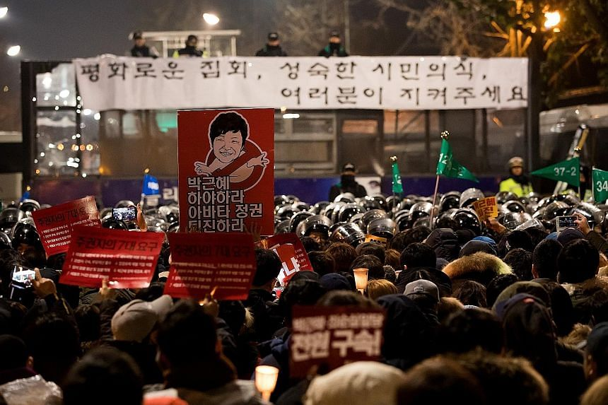 A rally calling for Ms Park's resignation in Seoul last Saturday. Prosecutors had asked to question the South Korean leader face-to-face by today.