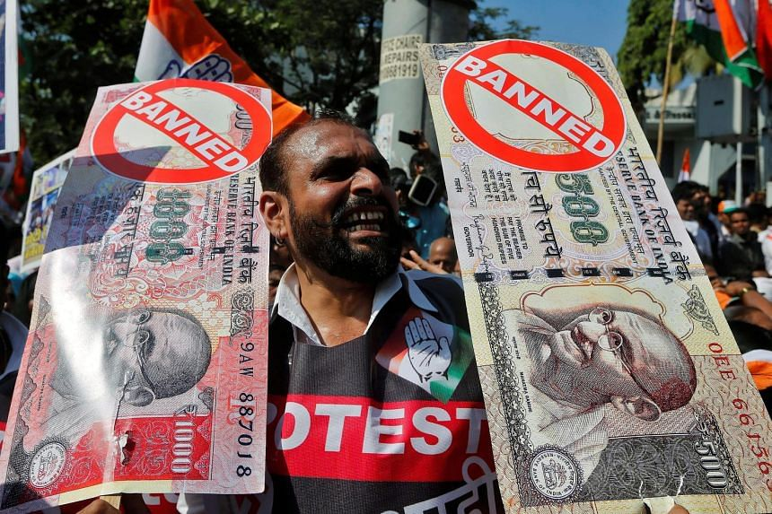 A rally in Mumbai organised by the Congress party against the government's decision to withdraw 500- and 1,000-rupee notes from circulation.