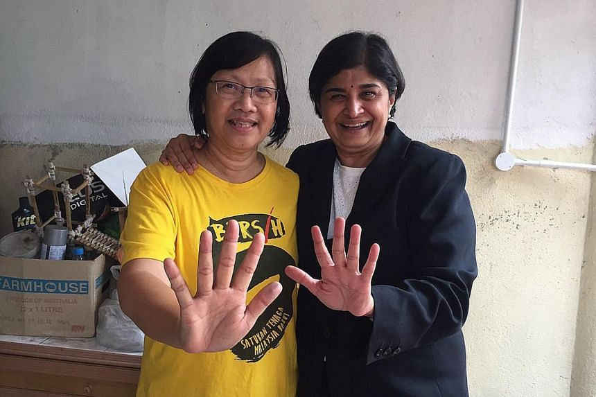 Ms Chin back home with Ms Ambiga after being released from police detention yesterday. She was held for being a key organiser of a street protest - Bersih 5 - against the government of Malaysian PM Najib Razak.