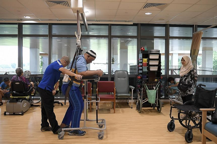 The community hospital, which was officially opened yesterday, has volunteers who tend rooftop gardens, teach patients crafts or bring books for them to read. Mr Rohaazman Ali, 47, a patient at Yishun Community Hospital, undergoing therapy after a sp