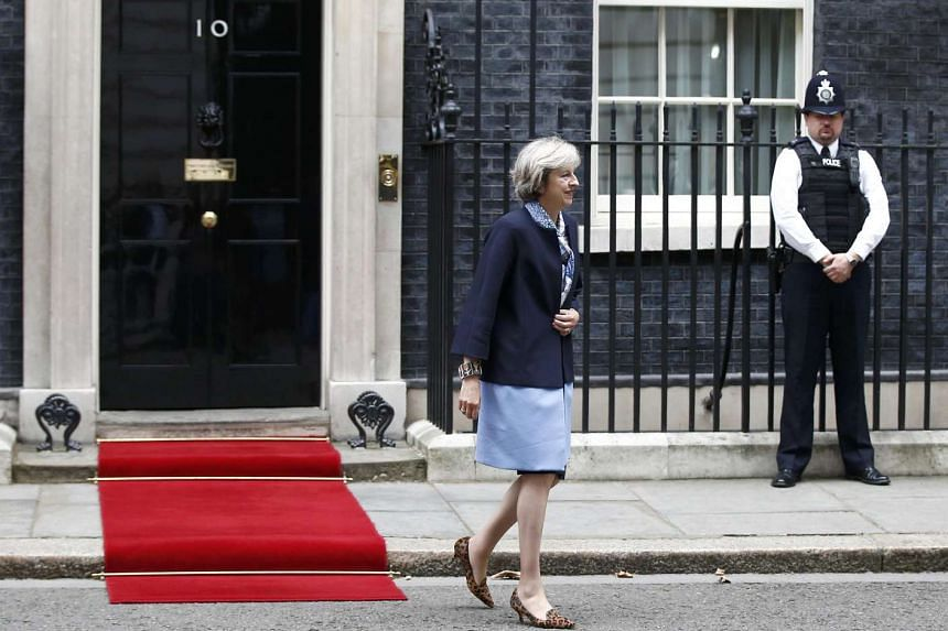 British Prime Minister Theresa May walking out of 10 Downing Street.