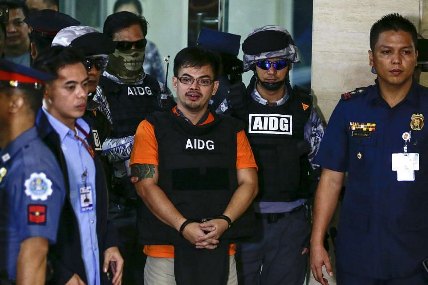 Alleged drug lord Rolando 'Kerwin' Espinosa Jr. (centre) is escorted on his arrival at the Philippine National Police headquarters in Quezon City, northeast of Manila, Philippines on Nov 18. Espinosa Jr., the son of late former Mayor of Albuera town
