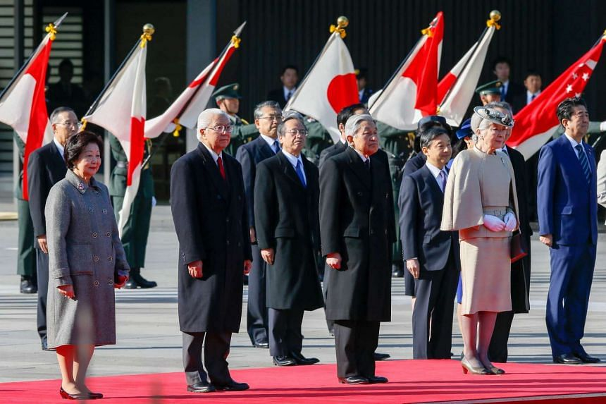 Singapore's President Tony Tan Keng Yam (second from left) and his wife Mary listen to the Singapore national anthem with Japan's Emperor Akihito and Empress Michiko during the welcome ceremony at the Imperial Palace in Tokyo on Nov 30, 2016.