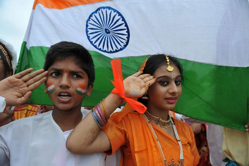 Indian school children salute as they stand to attention and sing the national anthem Jana Gana Mana in Hyderabad on Aug 30, 2012.