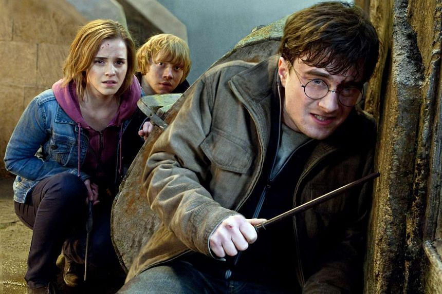 A cinema still from Harry Potter And The Deathly Hallows: Part 2, starring (from left) Emma Watson, Rupert Grint and Daniel Radcliffe.