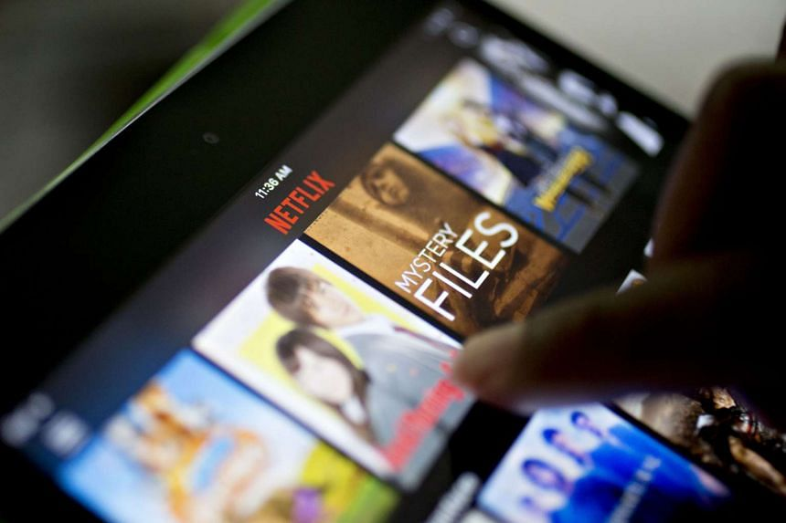The Netflix app is demonstrated on an Apple iPad mini tablet computer in July 2016.